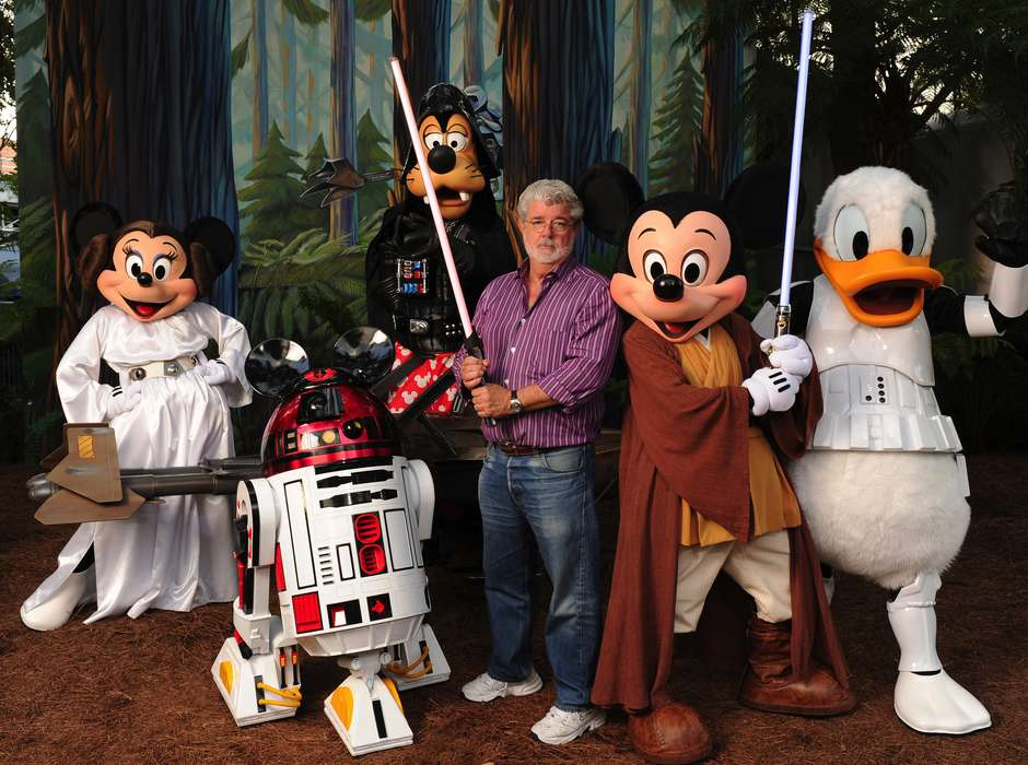 "(Aug. 14, 2010):  With the stern and determined look of a Jedi Knight, ""Star Wars"" creator and filmmaker George Lucas poses with a group of ""Star Wars""-inspired Disney characters Aug. 14, 2010 at Disney's Hollywood Studios theme park in Lake Buena Vista, Fla.  Lucas is in central Florida for ""Star Wars Celebration V,"" the official Lucasfilm fan event that is taking place this week at the Orange County Convention Center in Orlando, Fla. He visited Walt Disney World Resort tonight to attend Disney's ""Last Tour to Endor"" special event.  (Todd Anderson, photographer)"