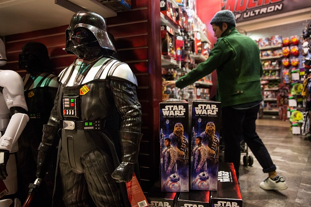 "NEW YORK, NY - DECEMBER 11: Toys from ""Star Wars: The Force Awakens"" are sold in the Toys R Us in Times Square on December 11, 2015 in New York City. Disney acquired Lucasfilm studios and the rights to the Star Wars franchise in 2013 for $4 billion. The film premieres next week on December 18, 2015.   Andrew Burton/Getty Images/AFP"